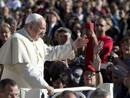 AP Pope Francis waves to faithful as he arrives for his weekly general audience in St. Peter's Square at the Vatican on Wednesday. Pope Francis waves to faithful as he arrives for his weekly general audience in St. Peter's Square at the Vatican on Wednesday.