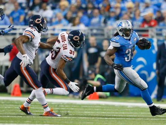 Detroit Lions running back Joique Bell (35) pulls away from Chicago Bears defensive back Al Louis-Jean (39) during the second half of an NFL football game in Detroit, Thursday, Nov. 27, 2014.