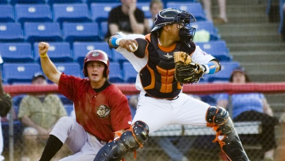 Binghamton's Juan Centeno throws to third during a
