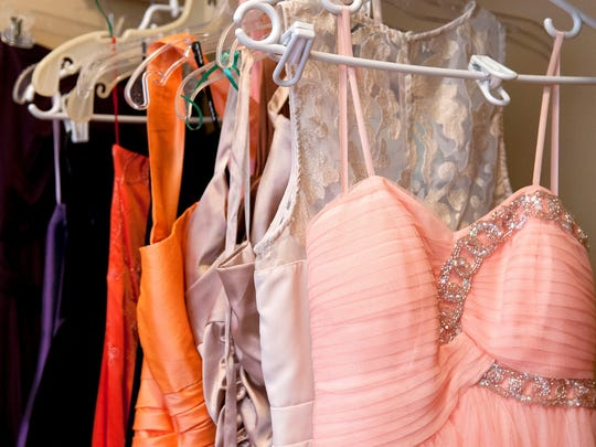 A small sample of the dresses available for the day's photo shoot for the Butterfly Project hang in the closet awaiting some lucky girl.