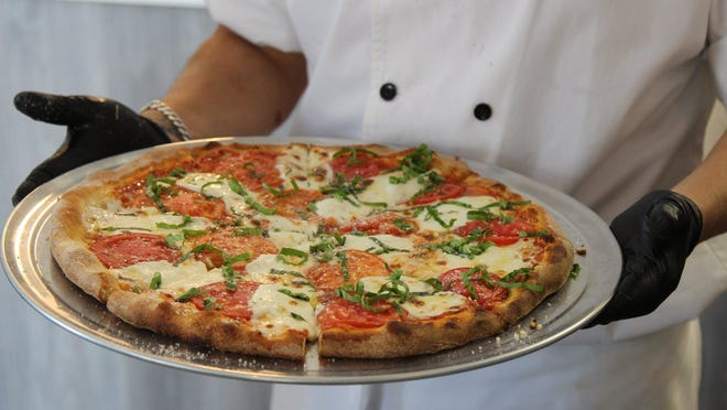A customized pizza at Cucina Jupiter, a new restaurant that's a full-service spin-off of Cucina Pizza by Design at the Palm Beach Outlets. The Jupiter location debuted in June.