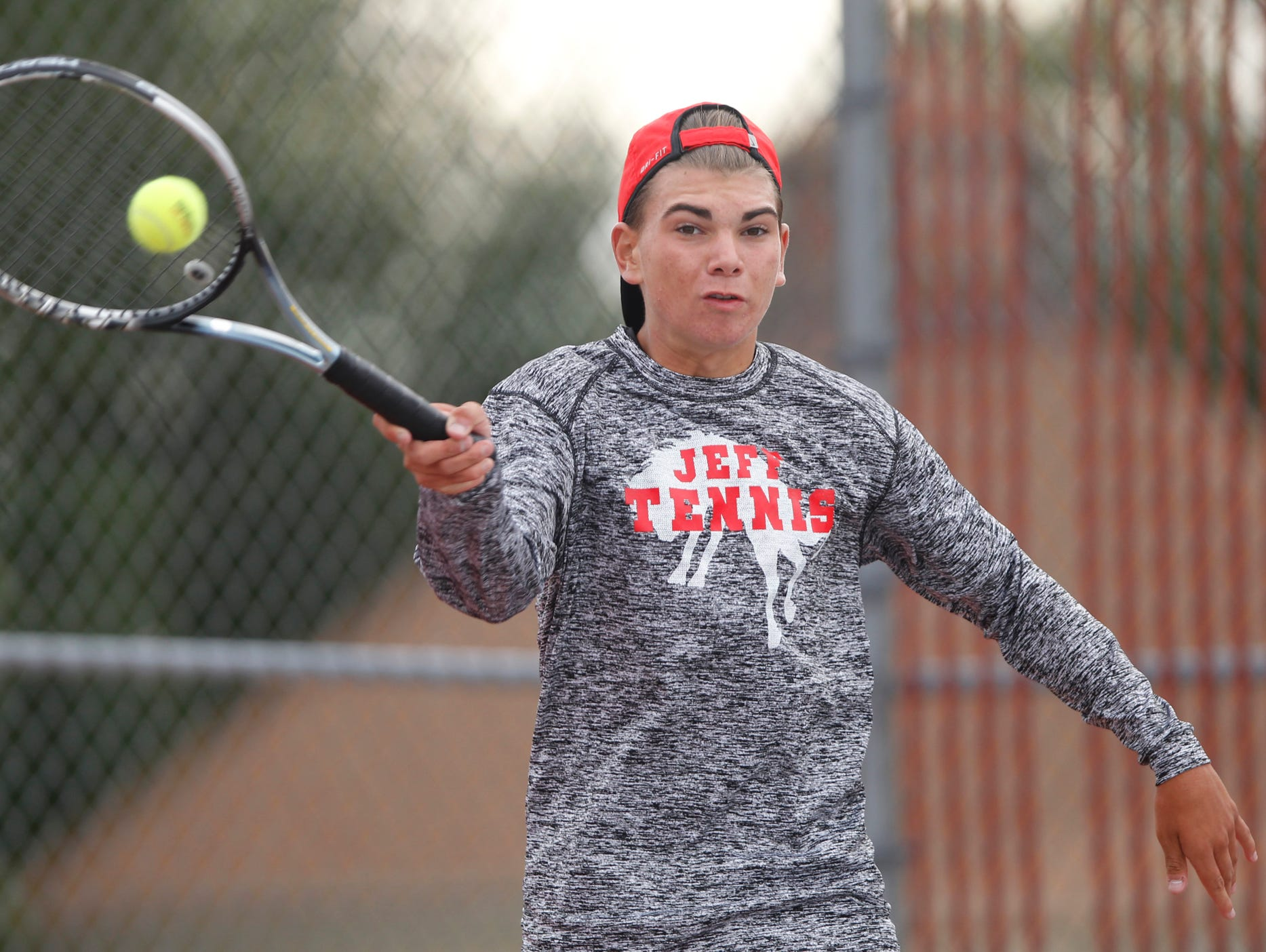 Lafayette Jeff's Ryan Walker with a return against West Lafayette's Arjun Ramani in No. 2 singles during the boys tennis sectional championship Friday, October 2, 2015, at Cumberland Courts in West Lafayette.