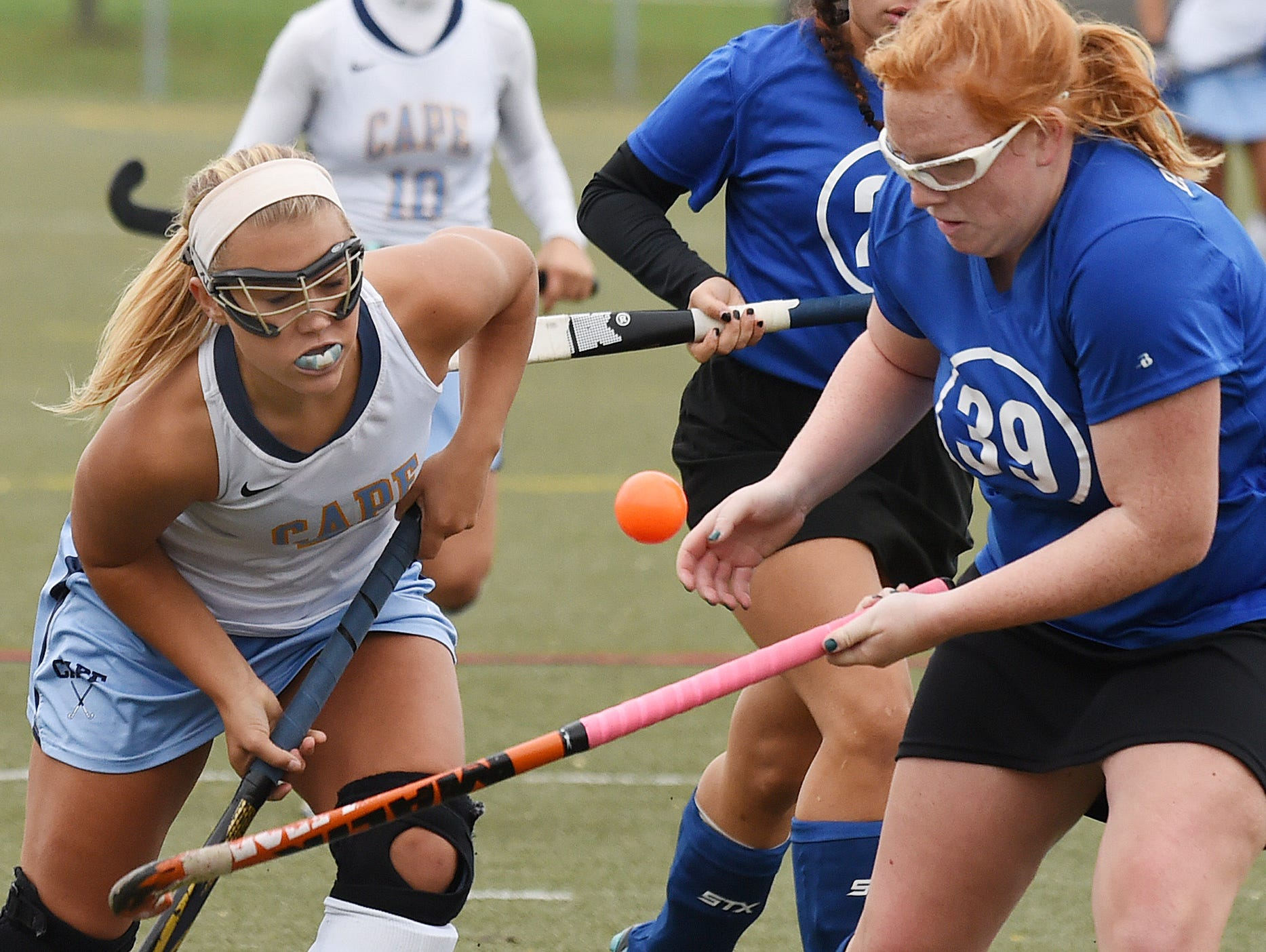 Brandywine's Laurel Bradley and Cape's Sydney Ostroski fight for the ball as Cape Henlopen High School (white) hosted Brandywine HS (blue) in the 1st round of the Delaware State HS Hockey Tournament at the school near Lewes on Wednesday November 11.