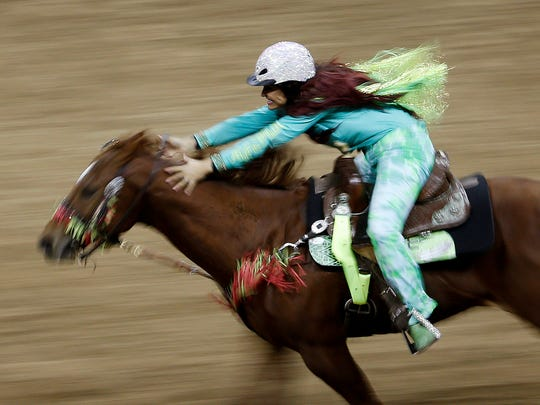 Fallon Taylor competes in barrel racing during the