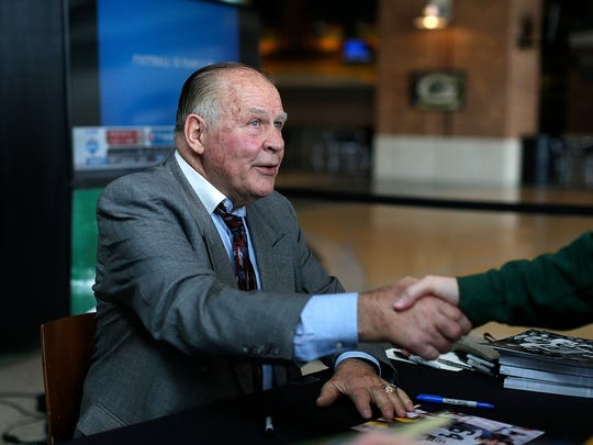 Green Bay Packers alumni Jerry Kramer greets a fan as he signs autographs during the Packers draft party April 29 inside the Lambeau Field Atrium.