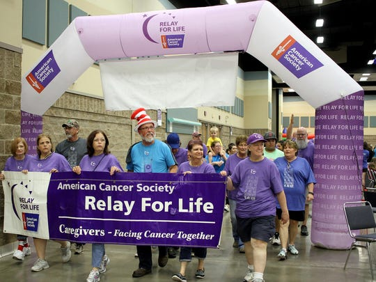 Cancer Survivors finish their first lap at the Wichita