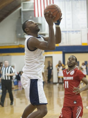 Woodbury's Daquan Brinkley goes up for two of his 16 points in Monday's South Jersey Group 1 victory over Paulsboro.