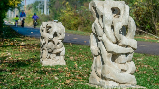 A pair of pieces by the late Peoria sculptor Bill Kwolek line a section of the Kellar Branch bike path in Peoria Heights. A third piece sits on the other side of the path.