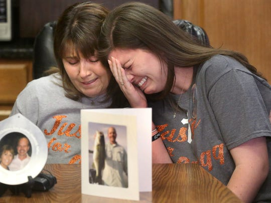 """Janet Hawkins, left, the widow of Gregg Hawkins, who was shot and killed on Oct. 16, 2015 at Mona Boat Ramp in Rutherford County, comforts her daughter Brandi Hwakins, right, who breaks down crying as she says """"We were just fishing"""" as she talks about her father's shooting, during a press conference held to announce a $40K reward leading to the arrest and conviciton of those involved in the crime. The press conference was held at the Rutherford County Sheriff's Office, on Thursday, Dec. 3, 2015."""