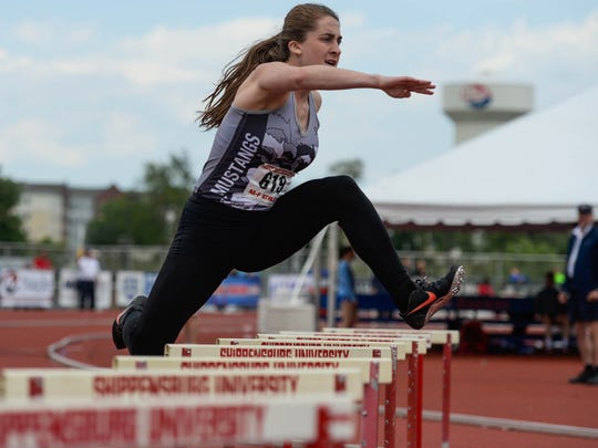 South Western's Lynne Mooradian competes in the 300-meter hurdles preliminary race during last season's PIAA Class AAA championships.