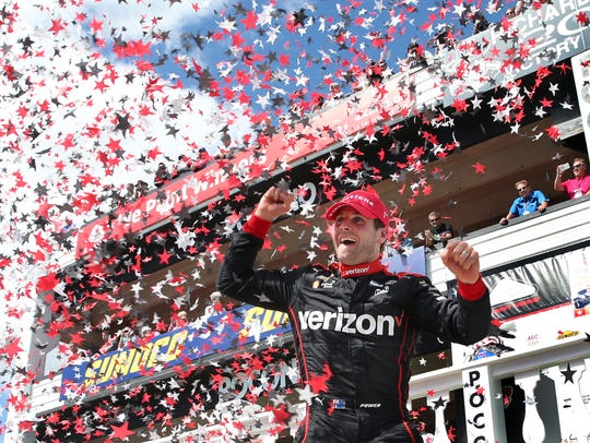 Will Power, of Australia, celebrates in Victory Lane