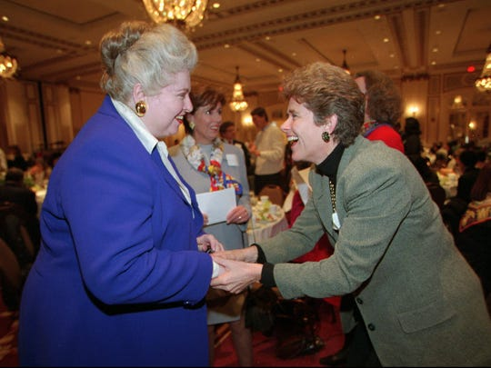 """Rayona Sharpnack, right, bows to attorney Sarah Weddington, left, and says, """"You are my hero,"""" at a luncheon in San Francisco honoring the 25th anniversary of the Roe vs. Wade decision. Weddington, who argued the landmark case, was the keynote speaker."""