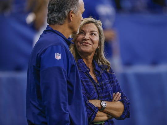 Tina Pagano, wife of Indianapolis Colts head coach Chuck Pagano, watches pregame warmups from the sidelines before the Colts face off against the Kansas City Chiefs at Lucas Oil Stadium on Oct. 30, 2016.