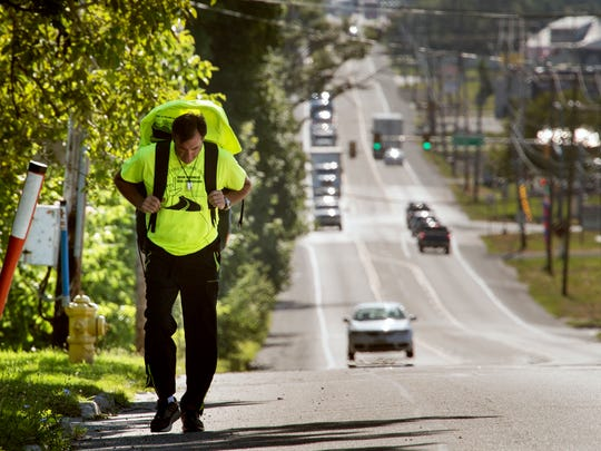 James Smith, 50, climbs his first hill on the trip on Route 30 in Thomasville Monday, heading west across York County, for a trip to span the United States. He is taking this journey, in part, for his kids, to show them that people are good.