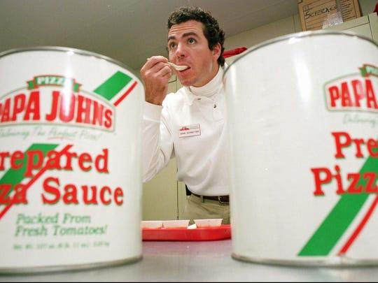 Papa John's founder John Schnatter tastes a spoonful of pizza sauce May 20, 1997.
