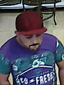 Surveillance footage of a man stealing jewelry from a North Naples store.