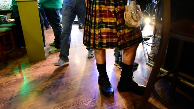 A man celebrates St. Patrick's Day by wearing a kilt at McCarthy's Restaurant & Pub in Port Clinton.