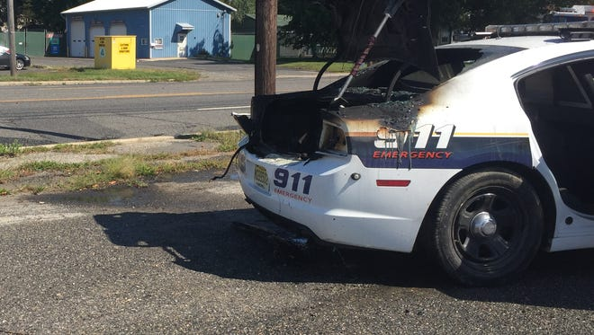 A fire broke out in the trunk of police car 806 as the officer drove down Park Avenue on Thursday.