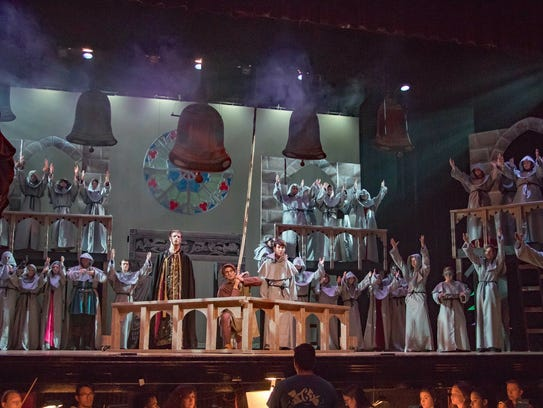"The super-sized cast of ""Hunchback"" sing one of the"