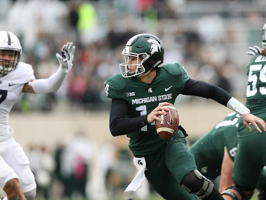Michigan State's Brian Lewerke looks to pbad against