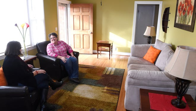 Jenny Bruce, right, sold her home almost immediately after it was staged by Realtor Sharon Kipp, left. Realtors say staging helps sell homes quickly in a competitive market.