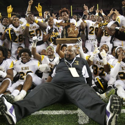 Detroit Martin Luther King head coach Dale Harvel sits