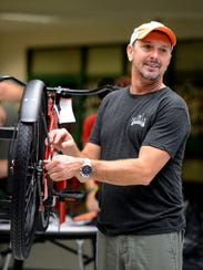 Donny Stoks helps put together bikes Saturday, Dec.