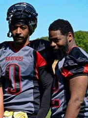 Bob Moore, left, played football with his friend Shannon Martin, who was shot to death Aug. 12 in York. Moore said football helped to keep the two out of trouble.