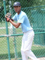 Domenick Doane of Loveland toes the rubber at the Under Armour tryout June 30 at the Midland Complex in Amelia.