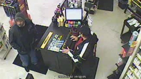 Surveillance video captured the suspect police said robbed the store at gunpoint on March 2.