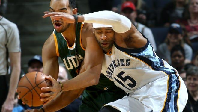 Memphis Grizzlies Vince Carter (right) collides with Utah JazzTrey Lyles (left).