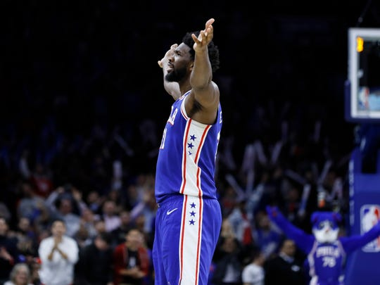 Philadelphia 76ers' Joel Embiid celebrates after making a basket during the second half of an NBA basketball game against the Denver Nuggets, Tuesday, Dec. 10, 2019, in Philadelphia. (AP Photo/Matt Slocum)