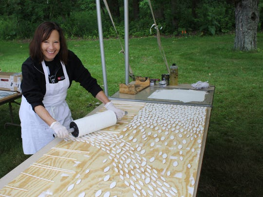 UW Colleges and UW-Extension Chancellor Cathy Sandeen joined printmakers from across the county to create Really Big Prints during the three-day event held in July 2016 on campus. The artists created large limited edition relief prints and used a steamroller to transfer the ink to the paper. UW-Manitowoc is one of the two-year UW Colleges campus located across the state.