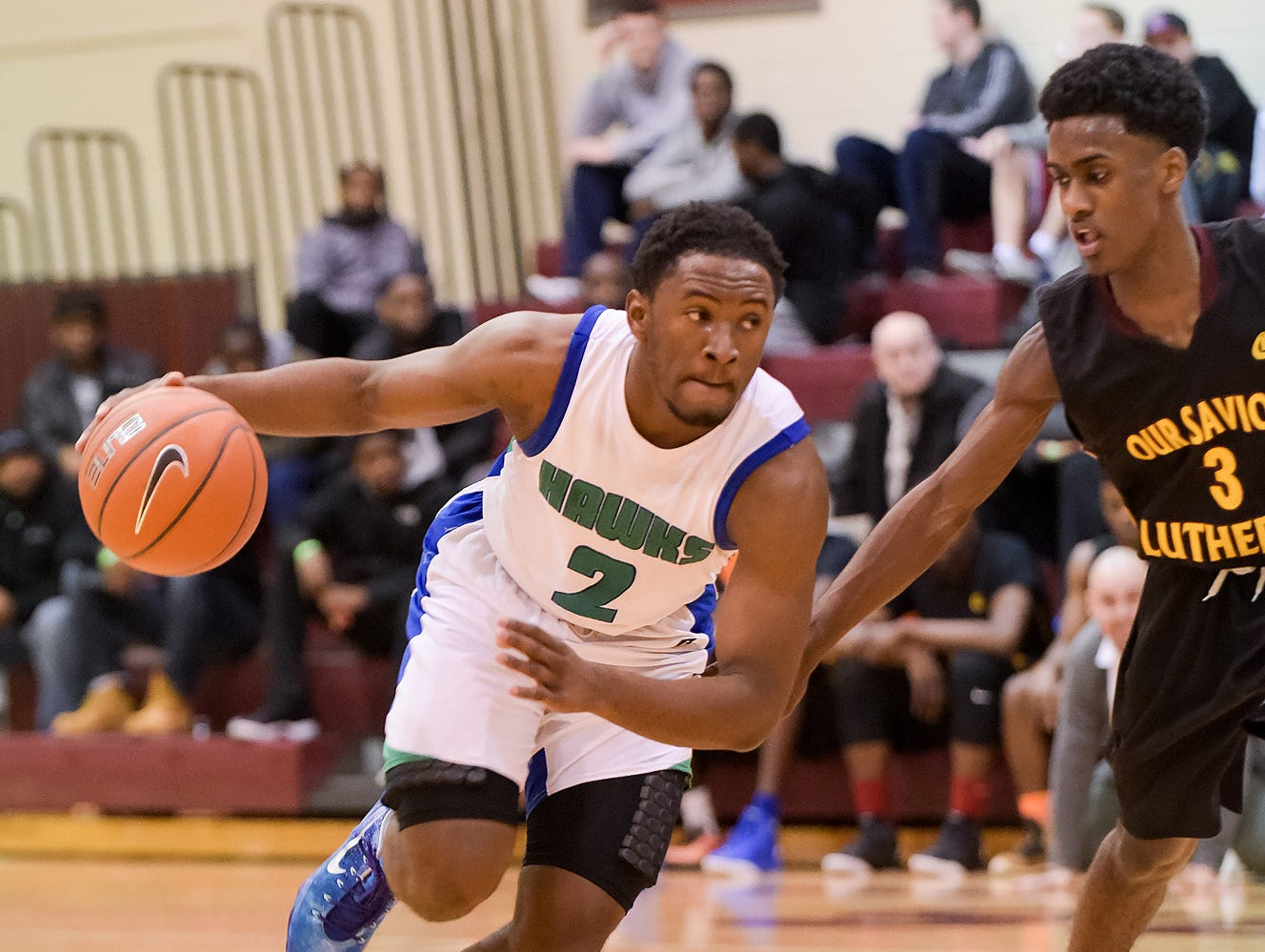 Kyson Rawls (2) of St. Georges drives against Matt Williams (3) of Our Saviour Lutheran of Bronx, N.Y., during the Concord Classic on Monday.