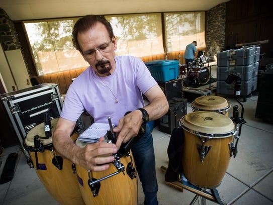 Jim Colestock prepares his percussion instruments for