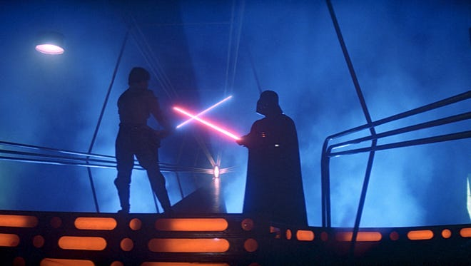 Mark Hamill as Luke Skywalker and David Prowse as Darth Vader (voice by James Earl Jones)  battle in 'Star Wars: Episode V - The Empire Strikes Back.' The two shared funny tweets on Father's Day.