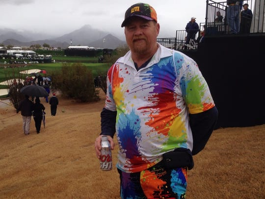 """Paul Randall, 53, of Tempe, says he often wears his colorful outfit while golfing at his local range in Phoenix.  """"Some guys don't like it, and some guys do,"""" he said."""