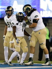 CSU tackle Nick Callender congratulates running back