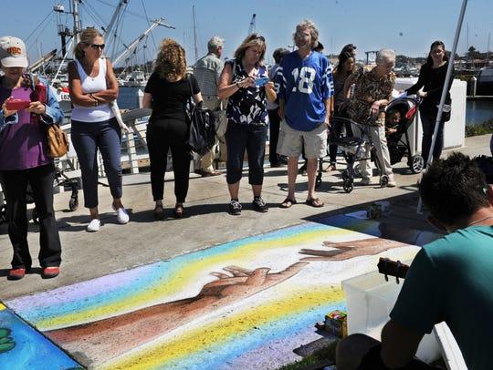 People admire artists work at the Ventura Art & Street