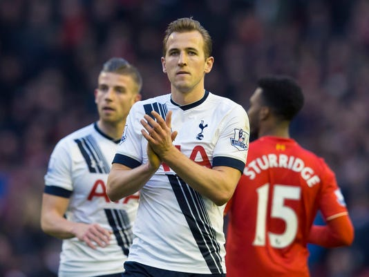 Tottenham's Harry Kane, centre, applauds supporters after his team drew 1-1 in the English Premier League soccer match between Liverpool and Tottenham Hotspur, at Anfield Stadium, in  Liverpool, England, Saturday, April 2, 2016. (AP Photo/Jon Super)