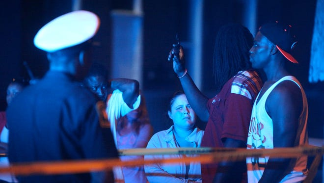 A crowd was gathered for hours on Chase Avenue at the scene on an officer-involved shooting late Tuesday night in Northside.