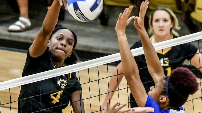 Garden City Community College's Meosha Erving goes up for a kill against Pratt in September 2019 at Perryman Athletic Complex. Erving is among the GCCC volleyball players to receive national recognition for their academic achievements.