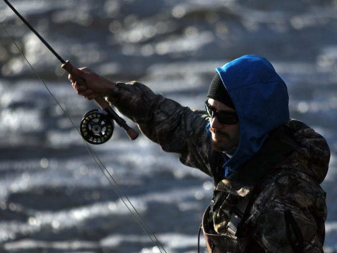 Jesse Gonzales, of Milwaukee, Wisconsin, casts a fly