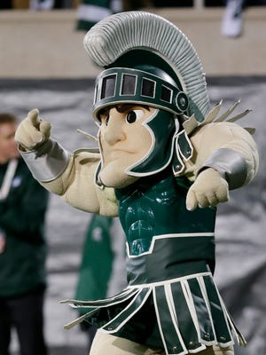 Sparty riles the crowd against Ohio State on Nov. 8, 2014.