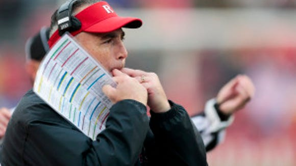 Rutgers coach Kyle Flood whistles to his team during the second half of an NCAA college football game against Wisconsin, Saturday, Oct. 31, 2015, in Madison, Wis. Wisconsin 48-10. (AP Photo/Andy Manis)