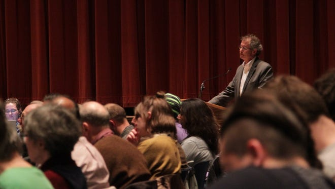 West Lafayette Mayor John Dennis addresses a packed house regarding the city's policies and obligations regarding undocumented immigrants during the West Lafayette City Council meeting on March 6, 2017, in West Lafayette. Dennis did not ask to council to vote one or the other, but advised the city to proceed with caution through changing times.