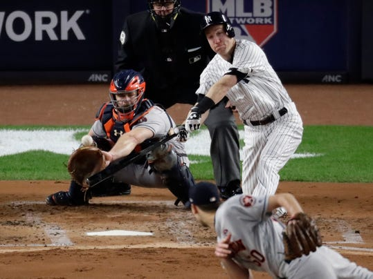 New York Yankees' Todd Frazier hits a three-run home run off Houston Astros starting pitcher Charlie Morton during the third inning of Game 3 of baseball's American League Championship Series Monday, Oct. 16, 2017, in New York. (AP Photo/Frank Franklin II)