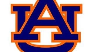 Auburn University is defending two football players accused of disrespecting a military veteran and her service dog.