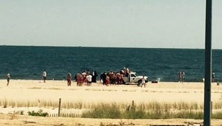 Responders gather when an 18-year-old Rockaway man was pulled from the ocean off Sea Bright Monday.