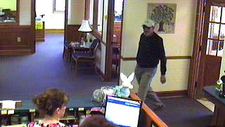 A security camera man suspected of robbing the Entegra Bank at 1617 Spartanburg Highway in Hendersonville.